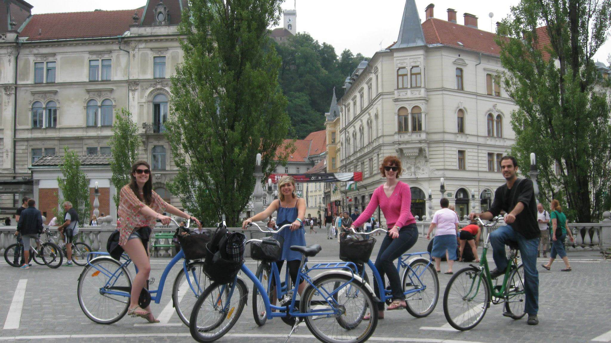 Gruop of turist on a bike tour through the city