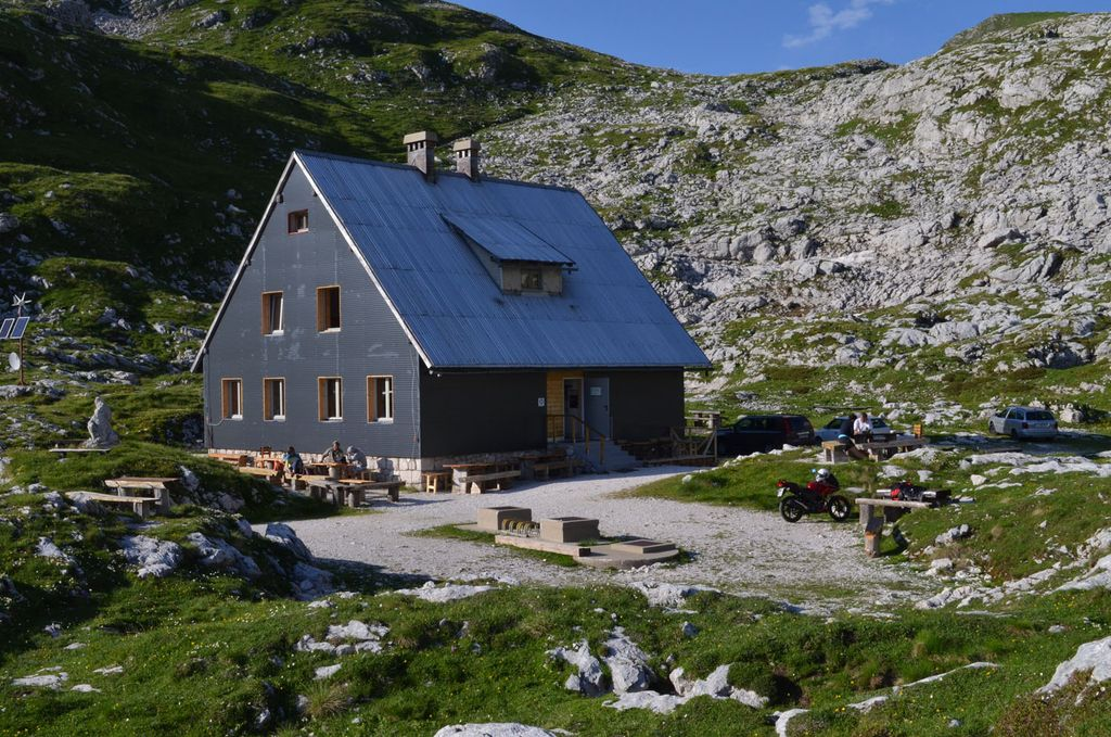 Mangart mountain hut in Slovenia is a starting point for Mangart hike and a great pit stop for your campervan road trip.