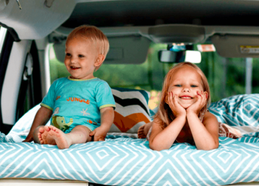 Kids having fun inside Stork campervan