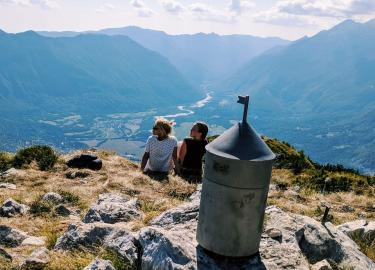 Two travelers enjoying top view from Bovec