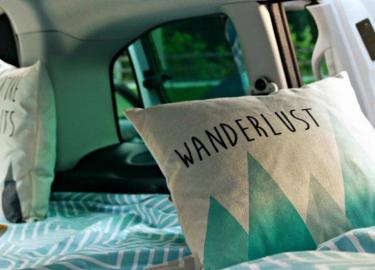 Wanderlust pillow in a NestCampers campervan
