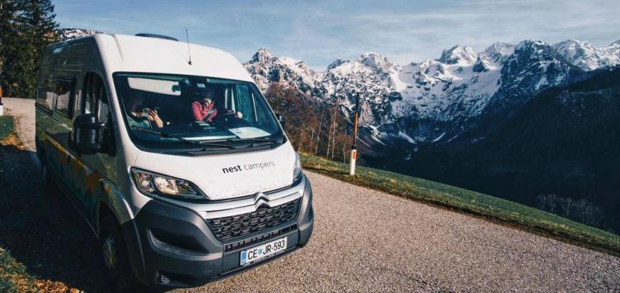 Campervan stork with mountain scenary