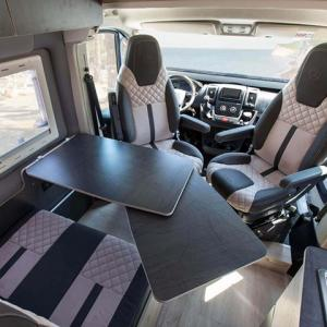 Adjustable desks inside campervan Falcon