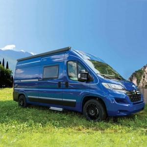 Blue campervan Falcon on the grass