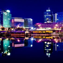 Vienna's skyline and river Danube in the night.