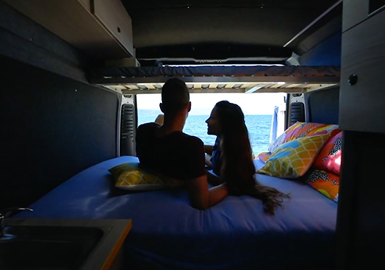 Couple enjoying camping life with a campervan